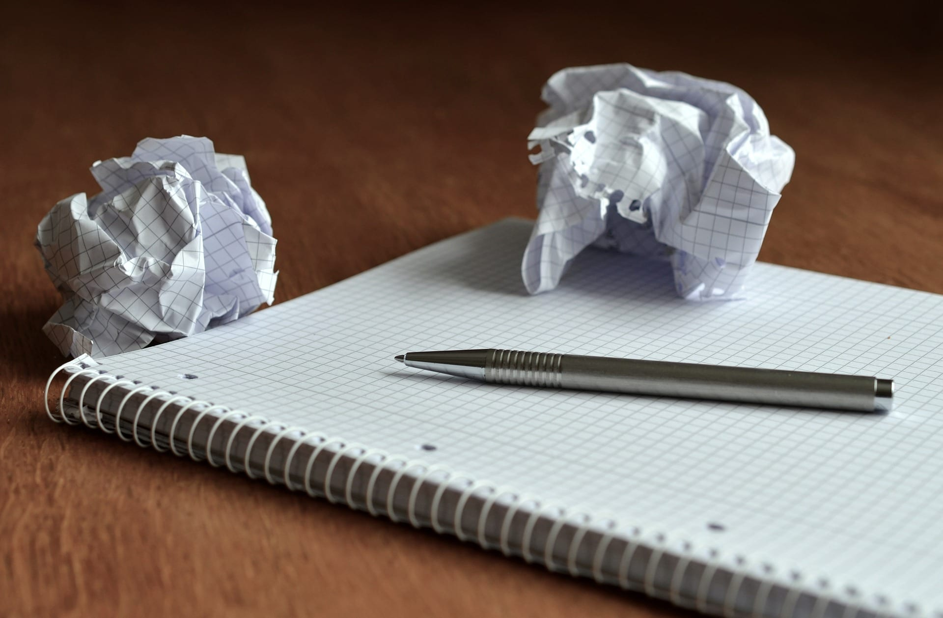 Crumpled piece of notebook paper